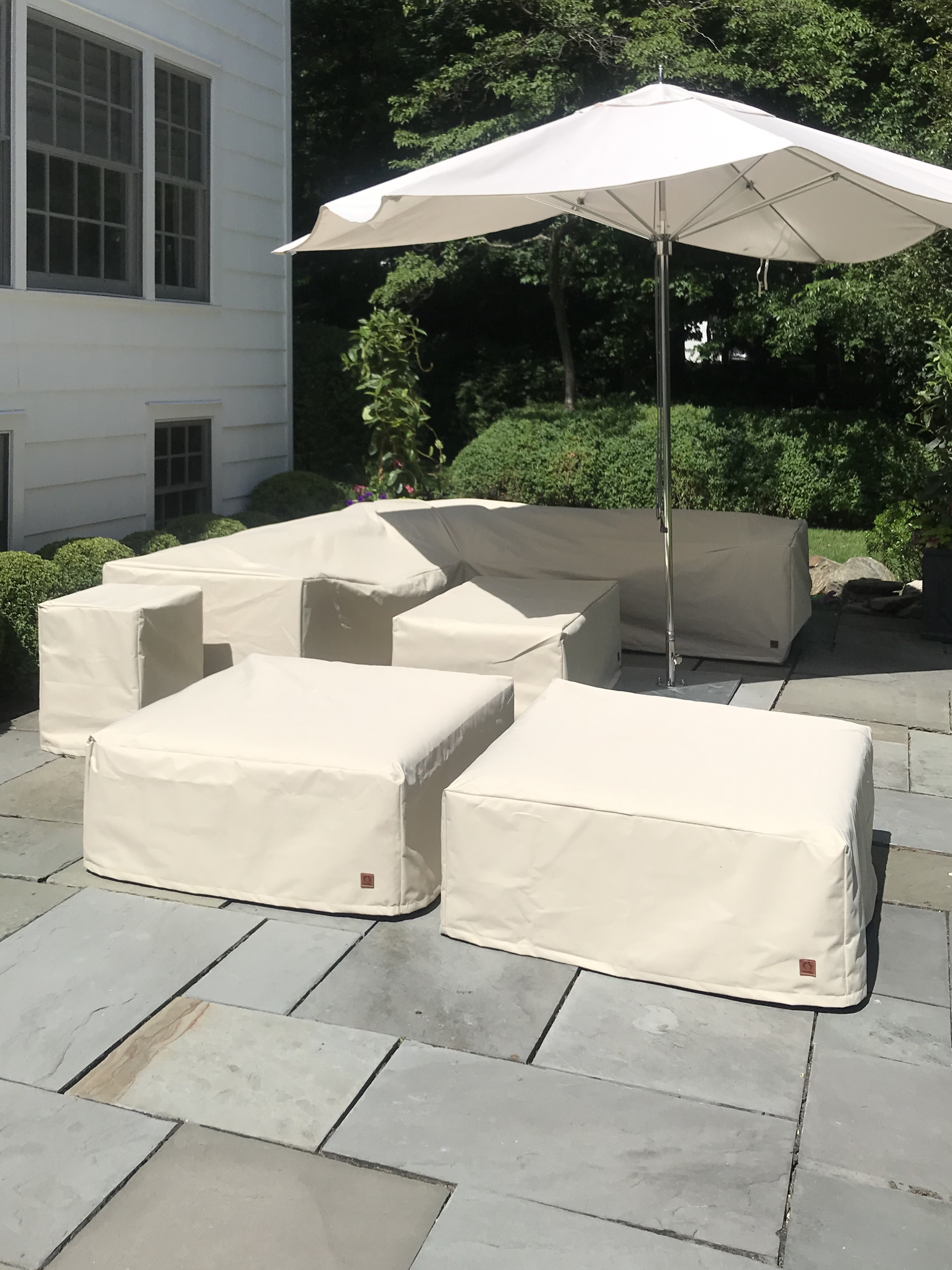 seating areas protected by CoverMes custom outdoor covers